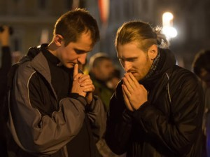 Priest-and-young-man-pray-together_medium